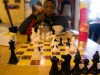 At basecamp, playing a game of chess and resting before we continue with the climb.